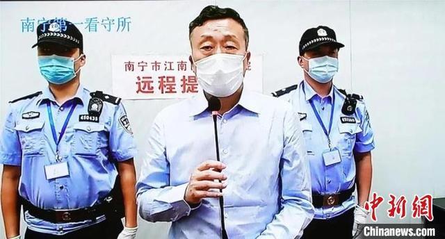 广西玉林市原公安局长李庄浩受审 涉受贿707万及包庇纵容黑社会组织【www.smxdc.net】
